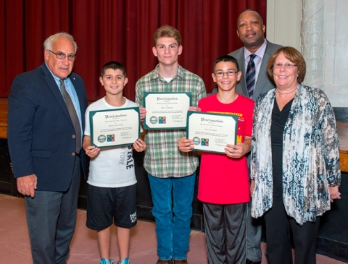 Photo Caption: (left to right) Patchogue Village Mayor Paul Pontieri; South Ocean Middle School students Dylan Lucchese, Eric Corrado, Nolan Crean; Suffolk County Community College President Dr. Shaun L. McKay, and South Ocean Middle School Principal Linda Pickford.'74