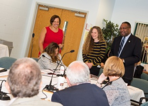 Tara Hack, center, was lauded by Suffolk County Community College President Dr. Shaun L. McKay, at right, and the College's Board of Trustees for her college-wide production Suffolk Hacked.