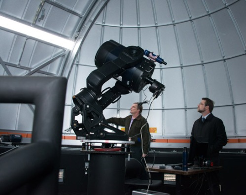 Associate Professor of Astronomy Matthew Pappas, at right, and Associate Professor Gerald Schnal watch as the Suffolk County Community College Observatory doors open to the heavens. Associate Professor Schnal worked tirelessly to perfect the remote operational capabilities of the observatory.